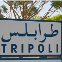 Traffic sign pointing to Tripoli, Libya.